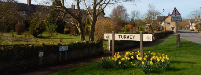 The Turvey village sign on Bridge Street at the bottom of Ladybridge Terrace | Photo by Jane Brewster