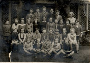 Photograph of schoolchildren outside the National School