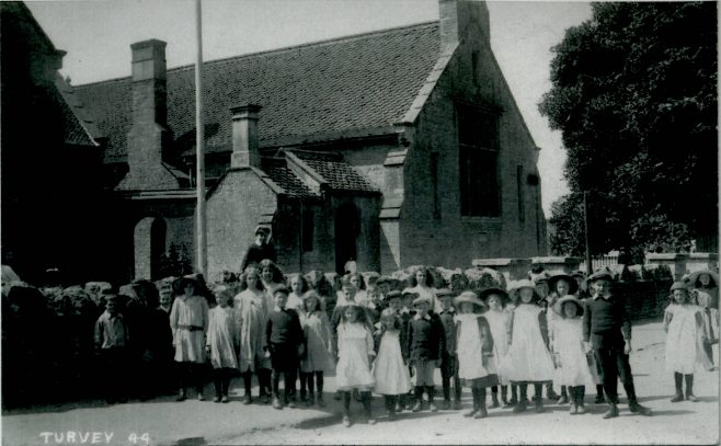 A group of Children outside the Village Hall