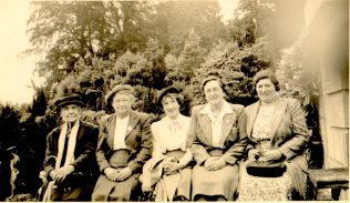 A Group of members of the Pleasant Wednesday Afternoon club in a Garden