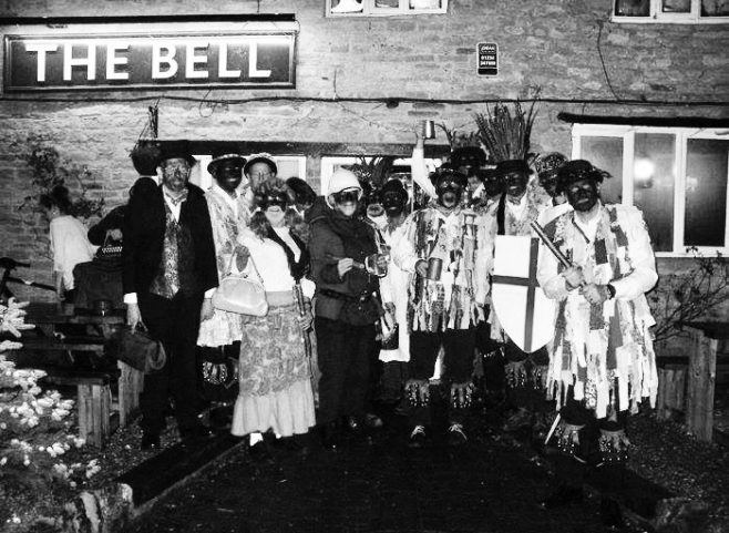 Bedford Morris Men in costume standing in front of The Bell pub in Odell | Image courtesy of Bedford Morris Men